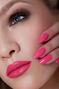 Manicure and Makeup. Beautiful Woman With Pink Nails and Luxury